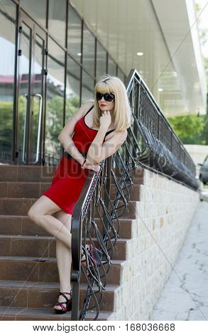 the woman in red on steps near office a subject beautiful business women