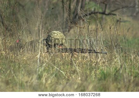 Military soldier at hideout with the kalashnikov