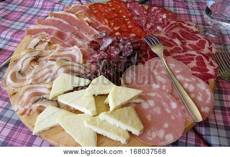 Italian antipasti platter with cold cuts and cheese in Italy