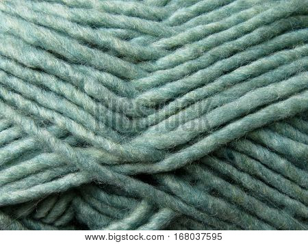 skein of green yarn with roving thread