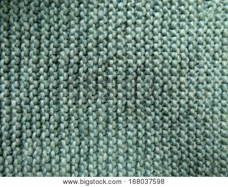 Green garter stitch knit roving yarn background texture