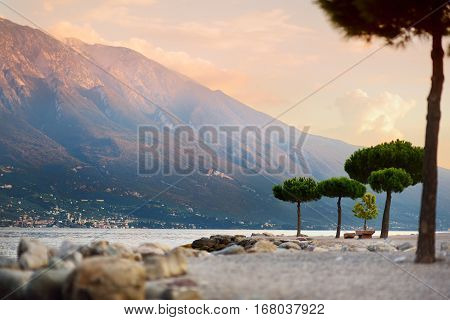 Scenic Sunset On A Beach Of Limone Sul Garda, A Small Town And Comune In The Province Of Brescia, It