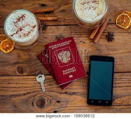 Passport, Notebook And Cup Of Coffee On Wooden Table