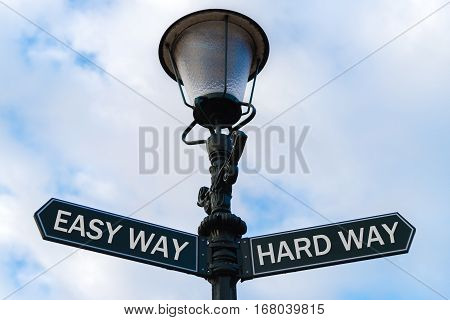 Easy Way Versus Hard Way Directional Signs On Guidepost