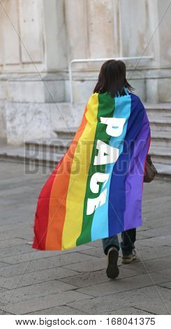 Person Walking With Multicolored Flag With The Inscription Pace