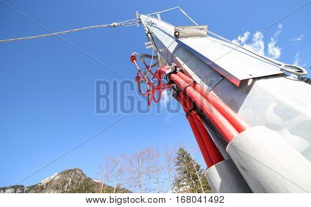Iron Pole Of An Electrical System With Cables And High Voltage I
