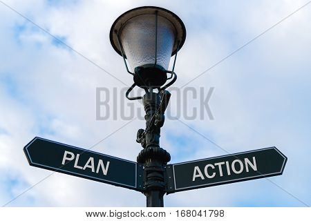 Plan Versus Action Directional Signs On Guidepost