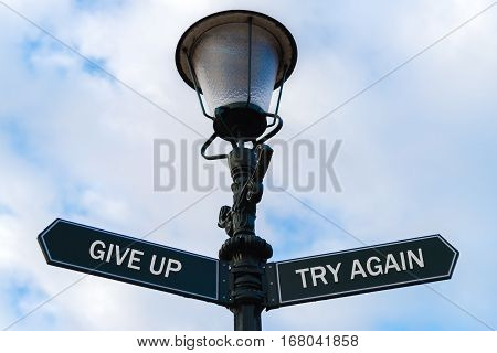 Give Up Versus Try Again Directional Signs On Guidepost