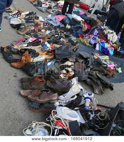 Used Clothes And Shabby Clothing In An Outdoor Flea Market