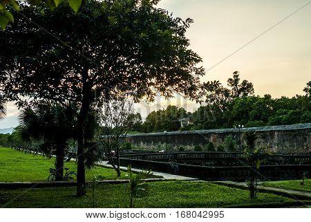 Purple Forbidden city wall in evening light in Hue. Vietnam.