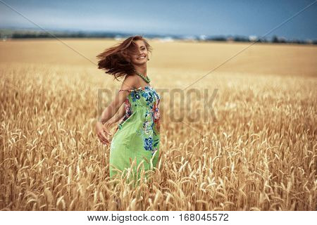 Photo of glad girl enjoying life in wheat meadow
