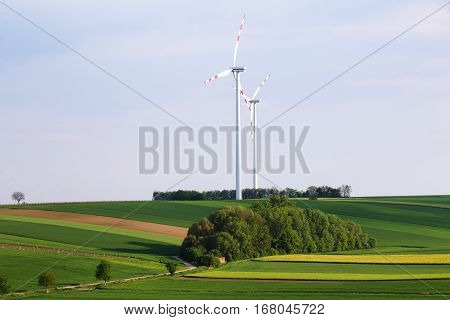 Wind power station over blue sky background. Perfect energy saver background. Alternative energy sources concept. Green energy production.