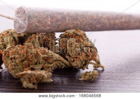 Close Up Of Dried Marijuana Leaves And Joint
