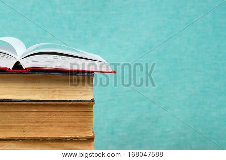 Open book stack of hardback books. Back to school. Copy space.