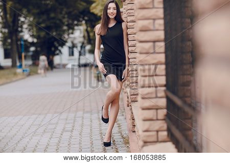 girl model walking around the city and posing for pictures