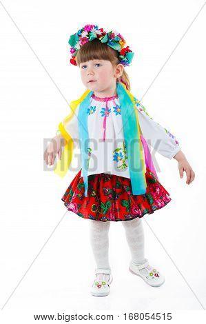 Beautiful Ukrainian baby girl costume, standing over isolated white background. Attractive Ukrainian woman wearing in traditional Ukrainian embroidery.