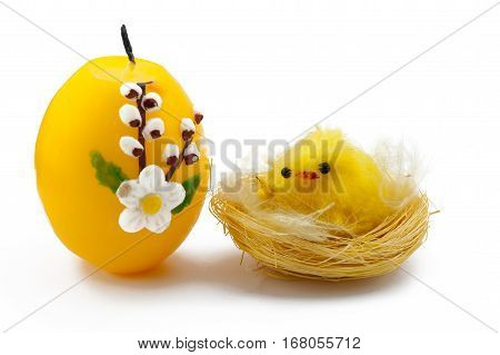 Little yellow Chick with Candle Egg on a white background
