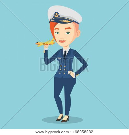 Young caucasian female pilot holding a model of airplane in hand. Cheerful female airline pilot in uniform. Smiling female pilot with model of airplane. Vector flat design illustration. Square layout.