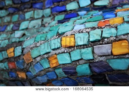 Colorful pattern of geometric mosaic old wall from smalt.