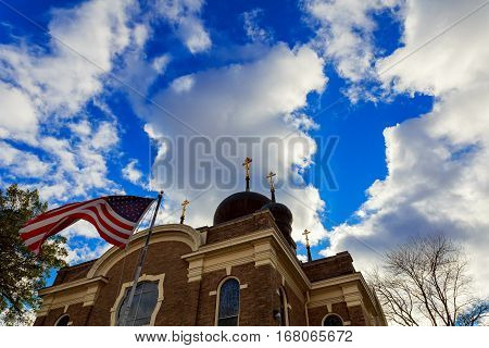American Flag And Church Steeple