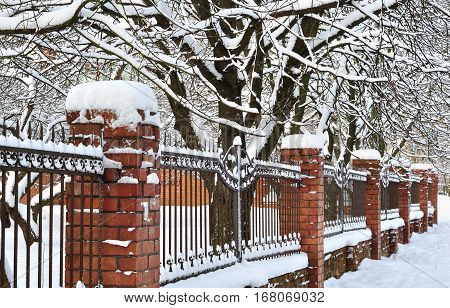 Photo of Fence lattice with brick columns in snow