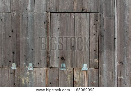 wood background texture with hatches, hinges, and latches