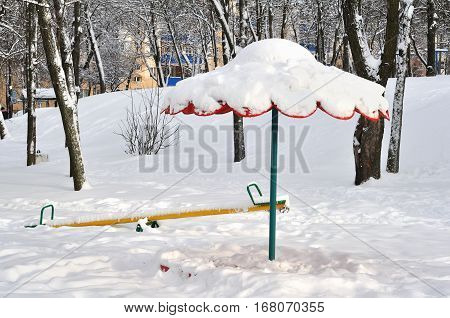 Photo of sandbox and a swing in winter
