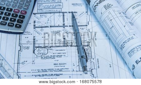 architecture blueprints and house remodeling plans on the table and technical pencil. architectural design on paper, construction technical plan, remodel project