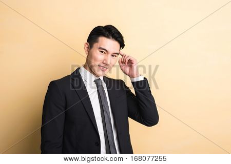 Asian business man got an idea, closeup portrait on studio yellow background