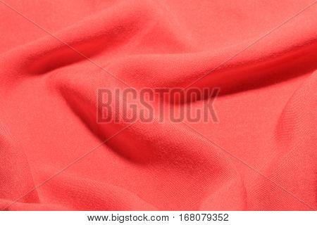 Pink cotton textile factory fabric texture waves and folds background.