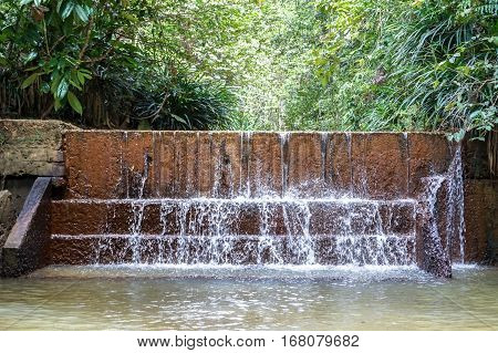 Borneo jungle forest with beautiful waterfall with amazing rock pattern in Beaufort,Sabah,Borneo.