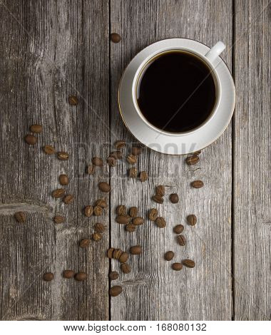 Coffee and coffee beans lying on a wooden table