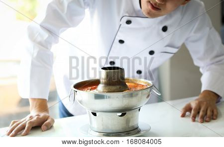 Chef Looking And Examining At The Food, Tom Yum Goong, Famous Thai Spicy Hot Pot