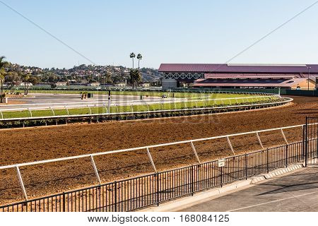 DEL MAR, CALIFORNIA - NOVEMBER 25, 2016:  Thoroughbred horse racing venue with dirt track and horse barn.
