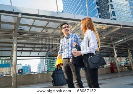 BusinessMan and Business Woman talking or Conversation Outdoor in Modern City as Business Communication Concept