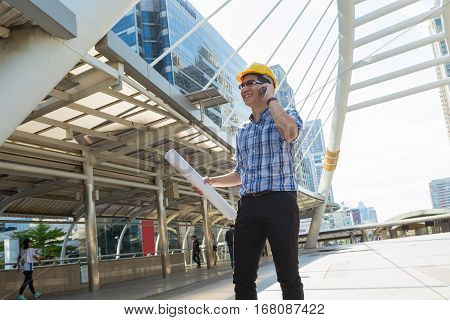 Man using Wireless Mobile Phone in Modern City