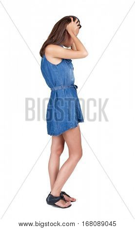 Back view of shocked woman in blue dress. girl hid his eyes behind his hands.  Rear view people collection.  backside view of person.  Isolated over white background.
