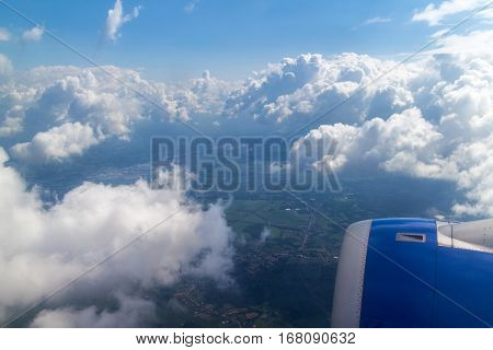 Clouds and sky as seen through window of an aircraft,
