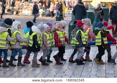 Krakow, Poland - December 16, 2016: Children age 6-7 years wlaking in a row on the street