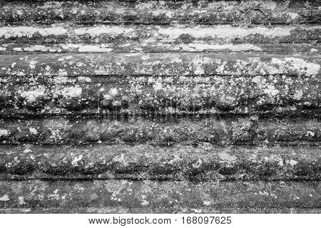 background and rough abstract texture of an old stone surface of monochrome tone