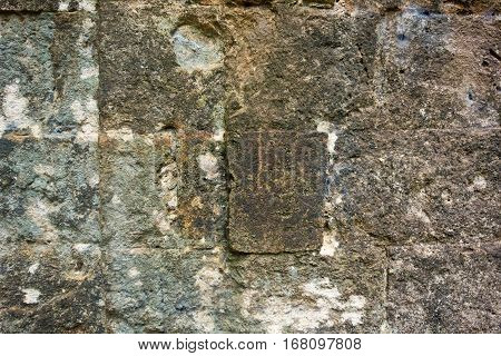 background and old texture of an ancient wall from a stone brick