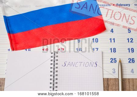 russia sanctions - flag, calendar and pen
