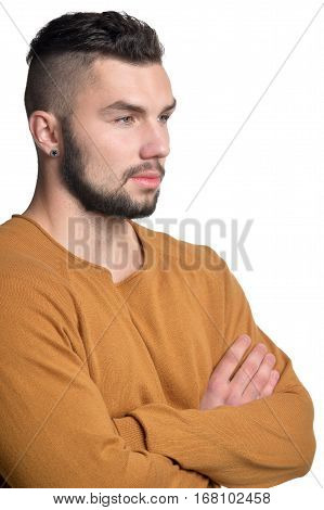 handsome young man posing against white background