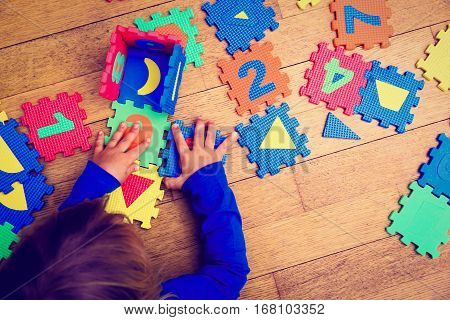 little girl playing with puzzle, early education and learning