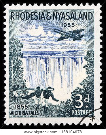 LUGA RUSSIA - SEPTEMBER 18 2015: A stamp printed by RHODESIA AND NYASALAND shows beautiful view of Victoria falls - a waterfall in southern Africa on the Zambezi River circa 1955