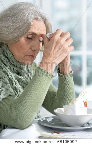 upset senior woman in cafe, waiting for somebody