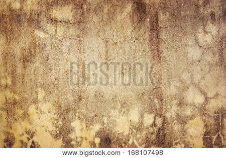 Old cracked plaster in grunge style useful like background - vintage texture