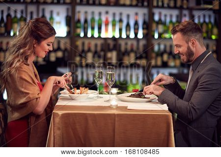 Dinner for two, couple in famous restaurant