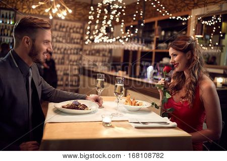 Romantic couple in love have dinner on Valentineâ??s evening in restaurant