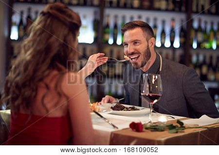 Couple at gala dinner in restaurant